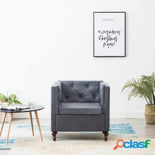 Sillón tapizado de tela gris