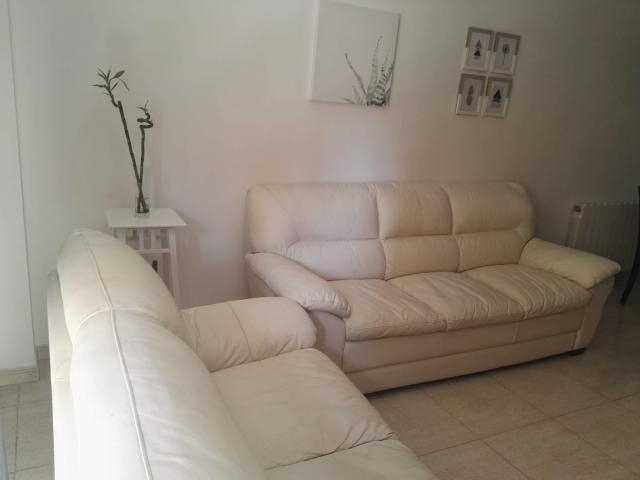 Conjunto sofás piel blanco