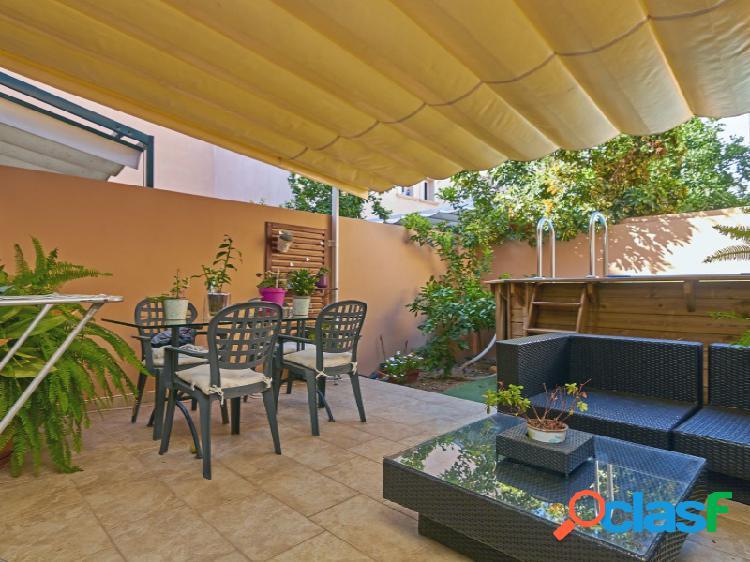Vivienda adosada con jardín de 50m2 en Arenal.