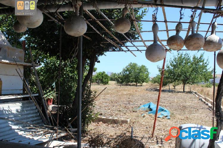 Terreno con casita a la venta