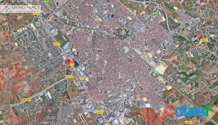 SOLAR 10.000 m2 JUNTO A CENTRO COMERCIAL EN DOS HERMANAS -
