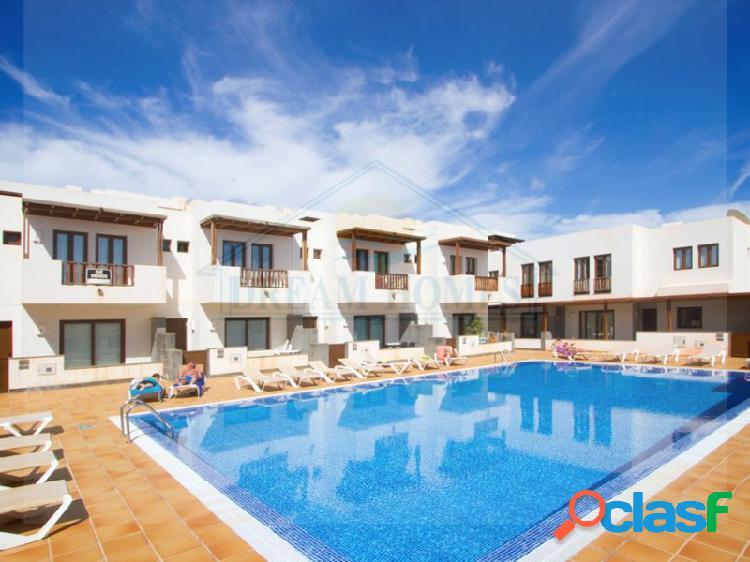 Duplex con piscina comunitaria, ideal para familias, en