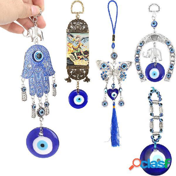 Herradura turca del mal de ojo azul con elefante y cintas