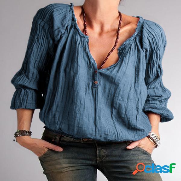 Blusa de manga larga con botones y volantes en color liso