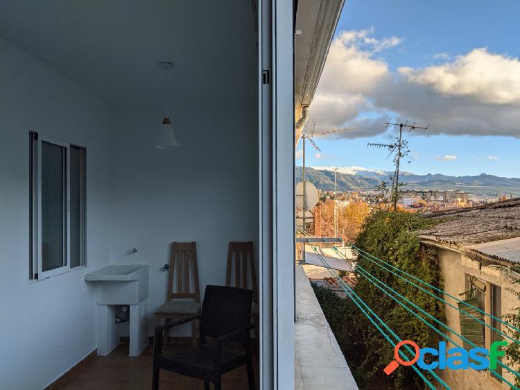 Pisazo con terraza acristalada de 2 habitaciones