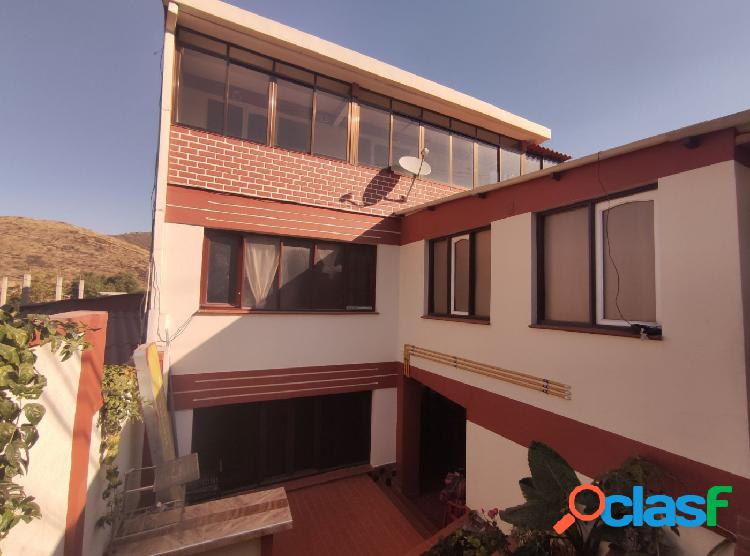 255.000 $us amplia casa Multifamiliar sobre la avenida