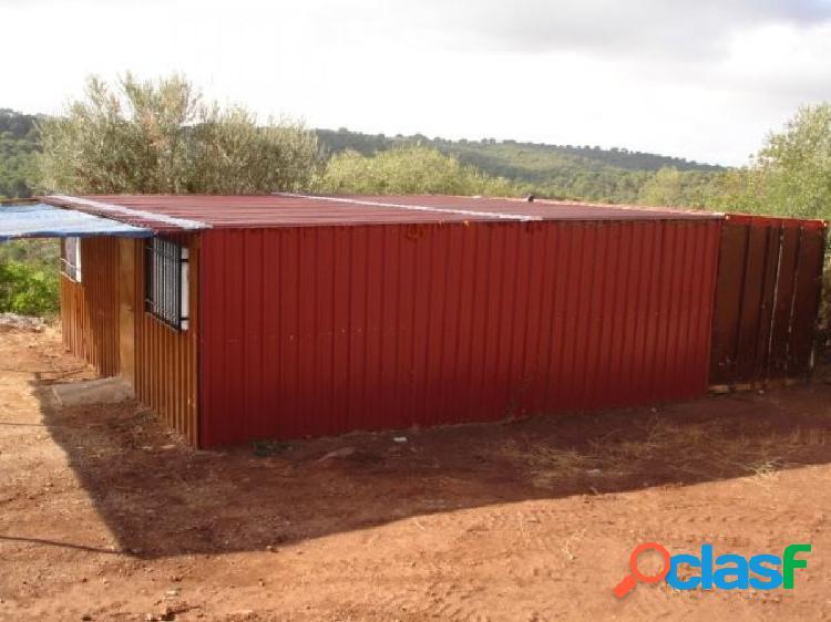 Parcela de 1.500 m2 con casa prefabricada de 90 m2 por el