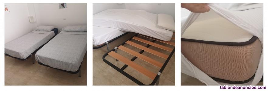 Dos camas individuales como nuevas